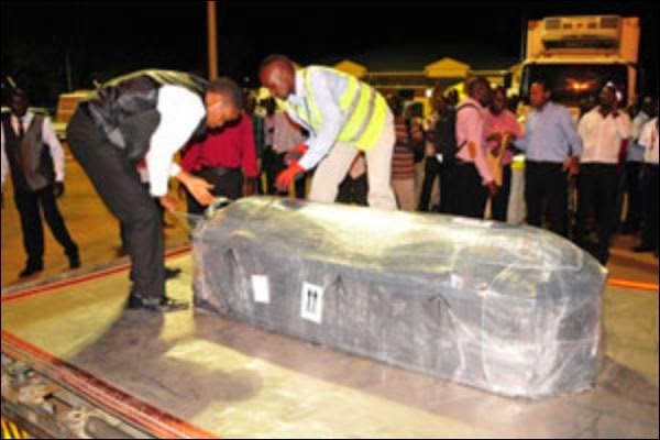 photos of juliana kanyomozis son body arriving in entebbe