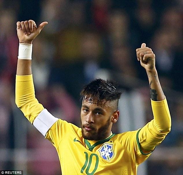 1416491956885_Image_galleryImage_Neymar_of_Brazil_celebrat