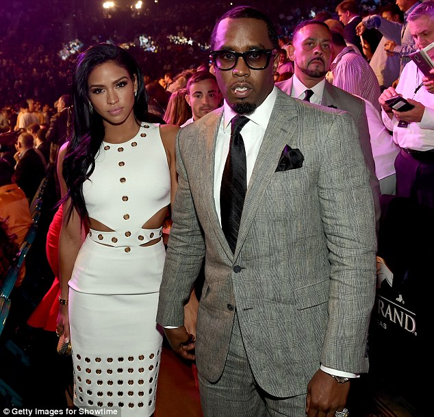 2842376400000578-3065913-Fight_night_Model_Cassie_Ventura_left_and_P_Diddy_pose_ringside_-m-71_1430642104068