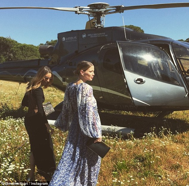 2A03543800000578-3141185-This_photo_showing_two_young_women_approaching_a_helicopter_was_-a-7_1435389230361