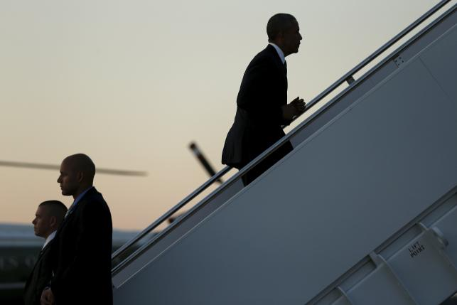 U.S. President Barack Obama boards Air Force One for travel to Kenya and Ethiopia from Joint Base Andrews, Maryland July 23, 2015. REUTERS/Jonathan Ernst