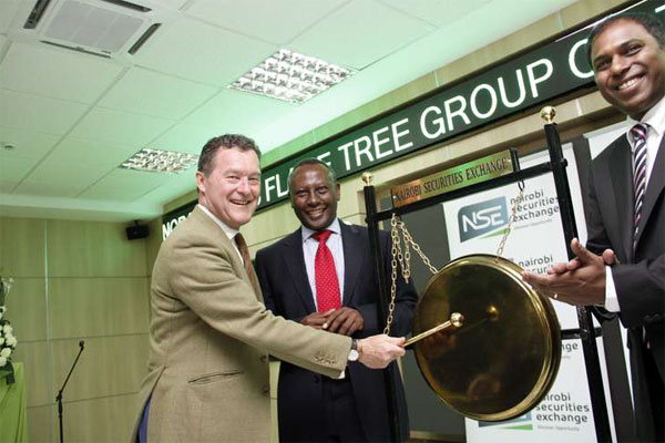 NSE Chairman Eddy Njoroge (C) looks on as Flame Tree Group George Theobald (L) and Flame Tree Group CEO Heril Bangera (R) during the listing of the group to the securities exchange's Growth and Enterprise Market Segment (GEMS) at sh 8 per share. Flame Tree Group is the first local manufacturer to list on GEMS. The event was held at the NSE on November 6, 2014 DIANA NGILA (NAIROBI)