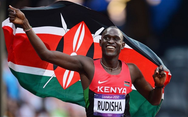 Olympics Day 13 - Athletics...LONDON, ENGLAND - AUGUST 09:  David Lekuta Rudisha of Kenya celebrates with his country's national flag after winning gold and setting a new world record of 1.40.91 in the Men's 800m Final on Day 13 of the London 2012 Olympic Games at Olympic Stadium on August 9, 2012 in London, England.  (Photo by Mike Hewitt/Getty Images)