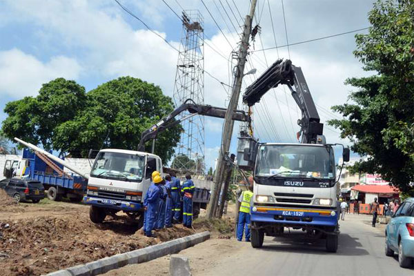 Kenya Power Company workers install a new transformer along the stadium road in Mombasa in this photo taken on 14th July 2015.  Photo by kevin odit.